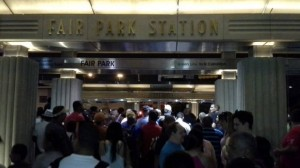 Crowd swarming train at Fair Park