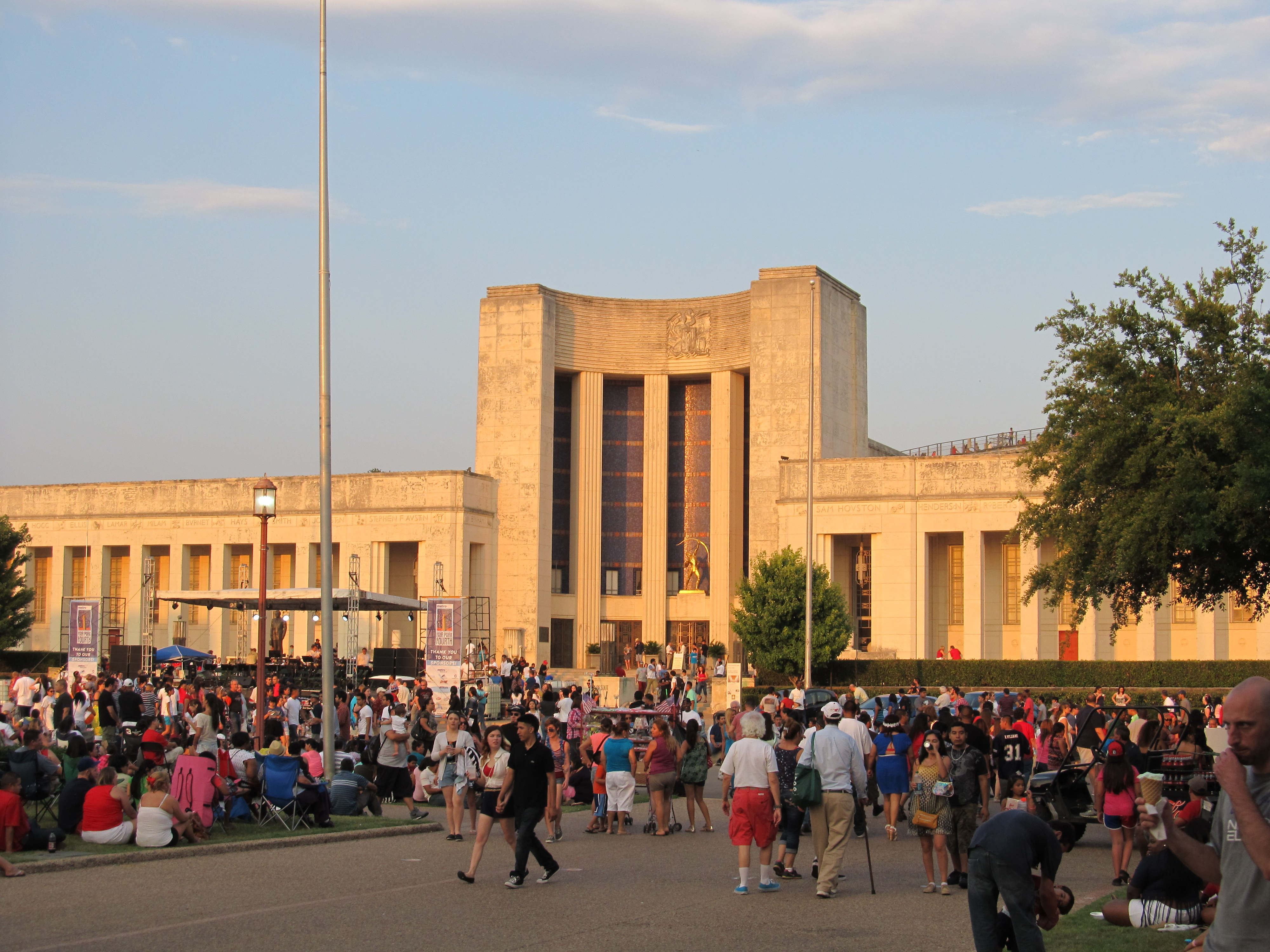 people gathering in front of the Hall of State