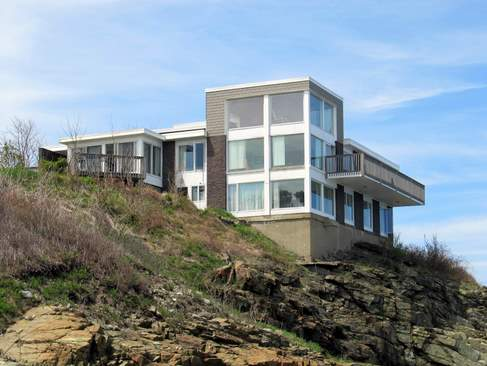 View of rear of house looking north from rocky shore