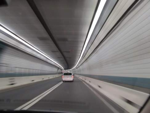 view from passenger seat driving through Boston tunnel